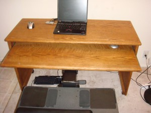 Humanscale keyboard tray attached to my oak desk